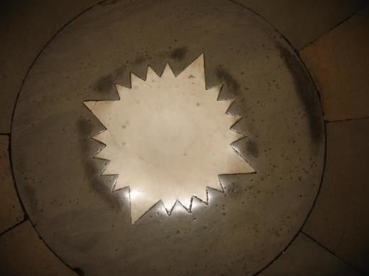 In the center of the Crypt, a white marble star is inlaid into the floor marking the center of Washington, D.C.