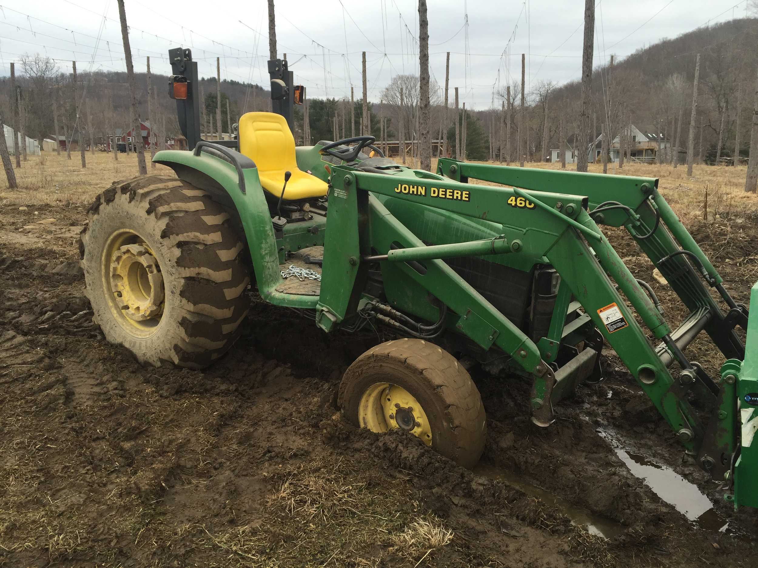 With the old farm came old farm equipment. Here's the old John Deere stuck up to the axel in mud.