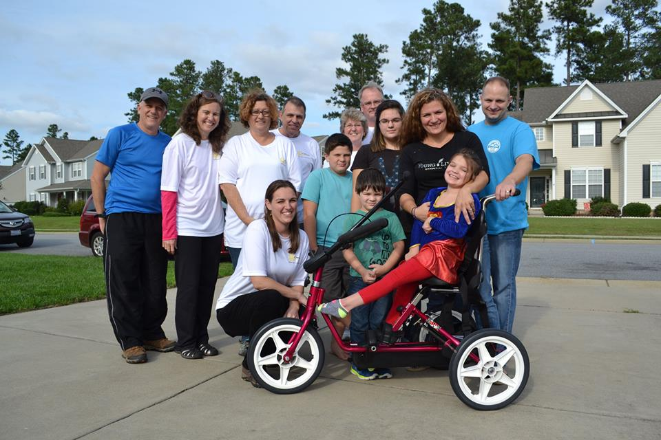 Therapy tricycle delivery for a SMILE child