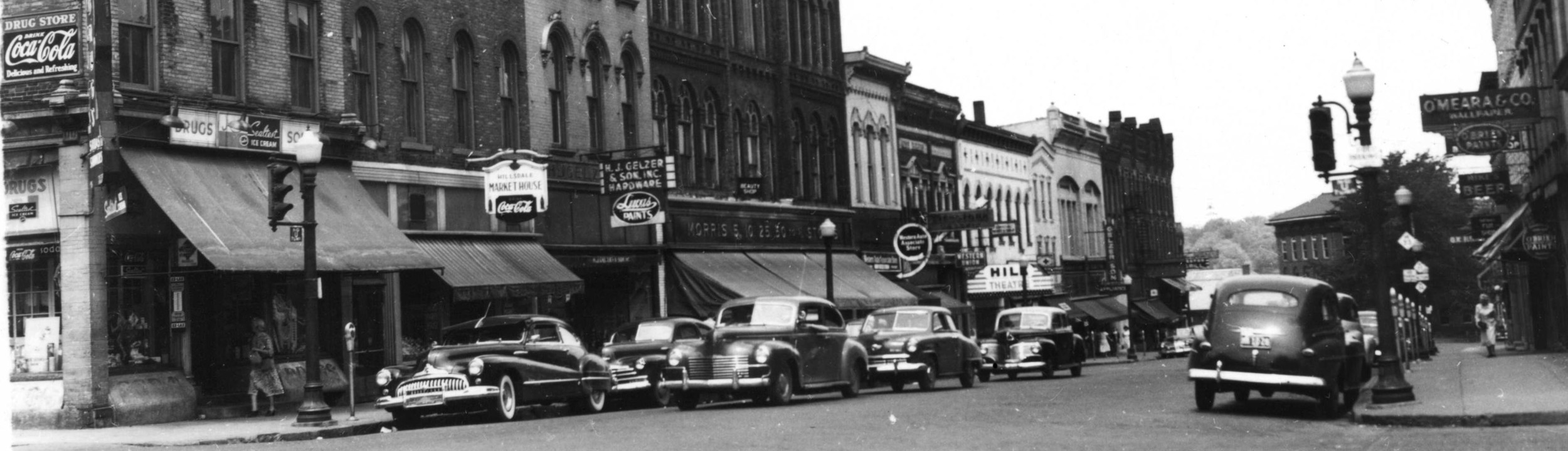 You can see the drugstore on the corner, Hillsdale Market house, O'Meara's,and Gelzer's.