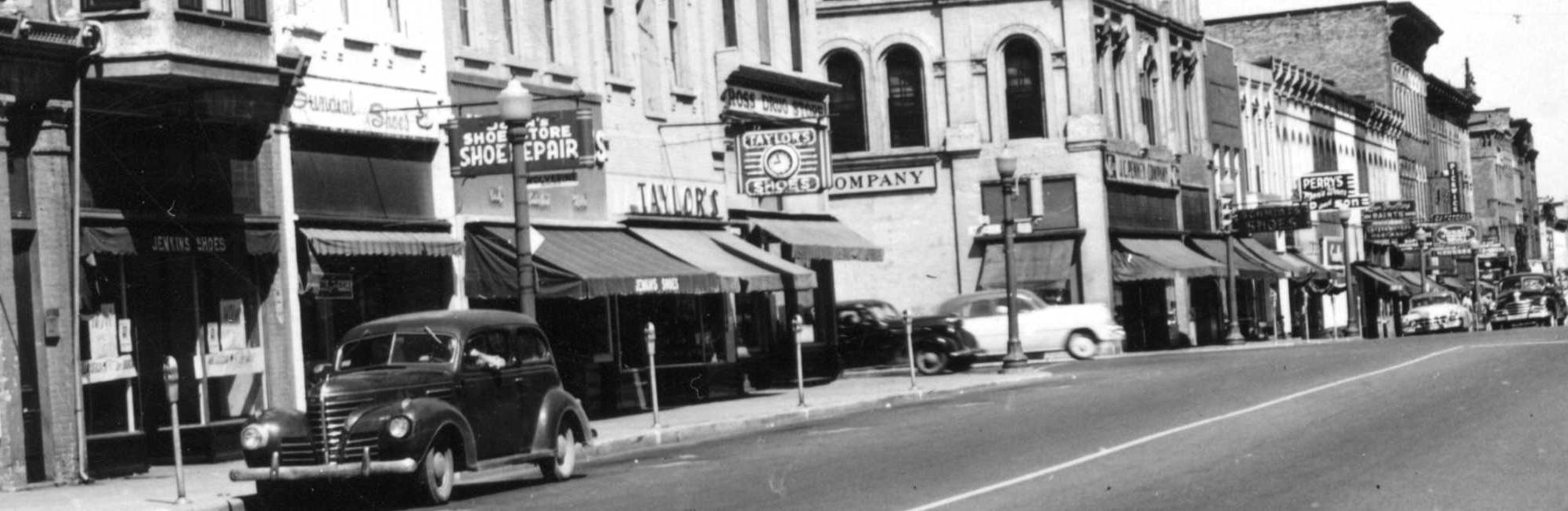 Here are several shoe stores along the street ,J.C. Penny's and Perrys Clothing store.