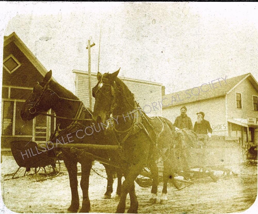 Horse Team Pulling Large Sled