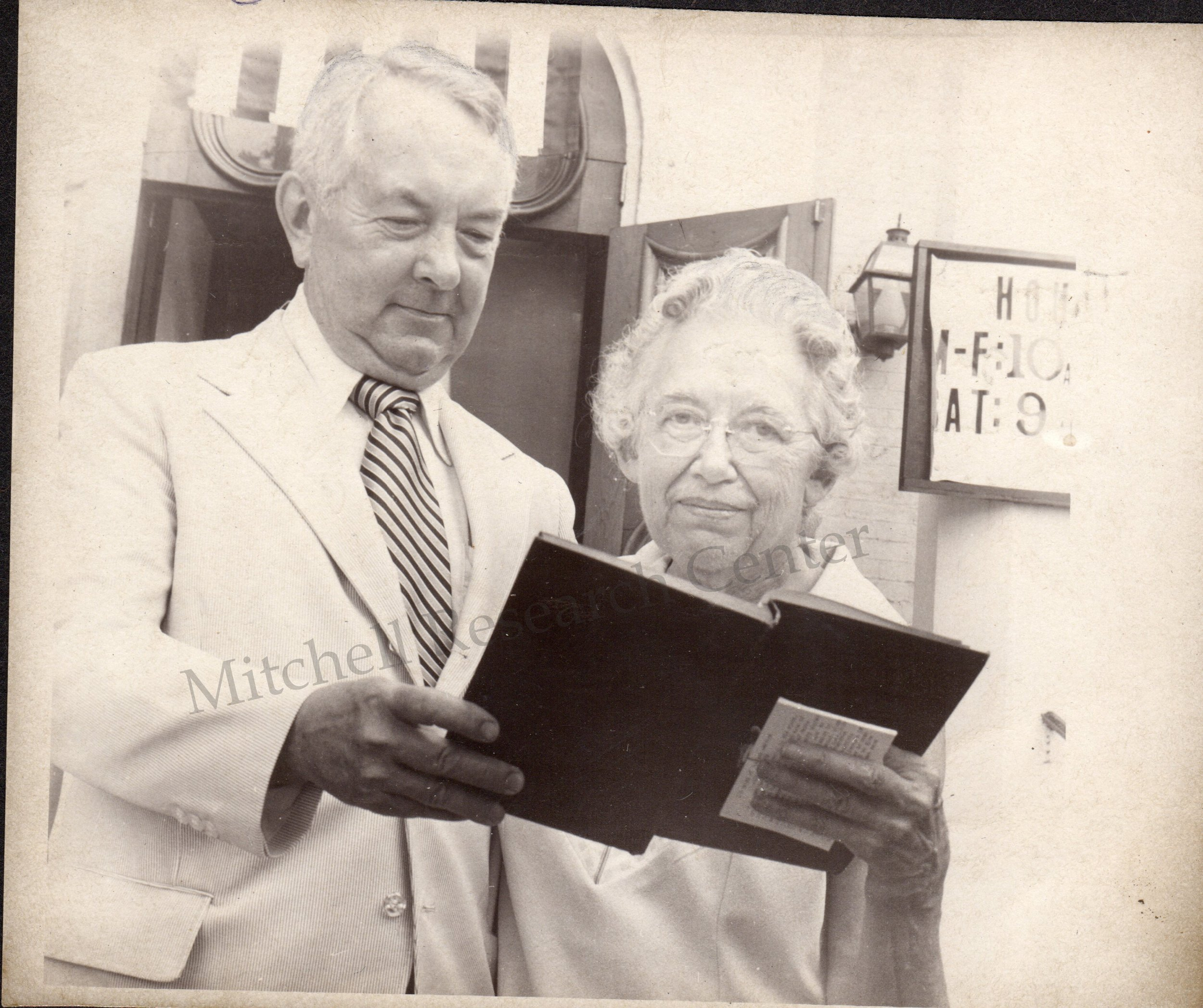 Thomas Sawyer & Louise Hawkes with book of Psalms printed 1871 for time capsule.