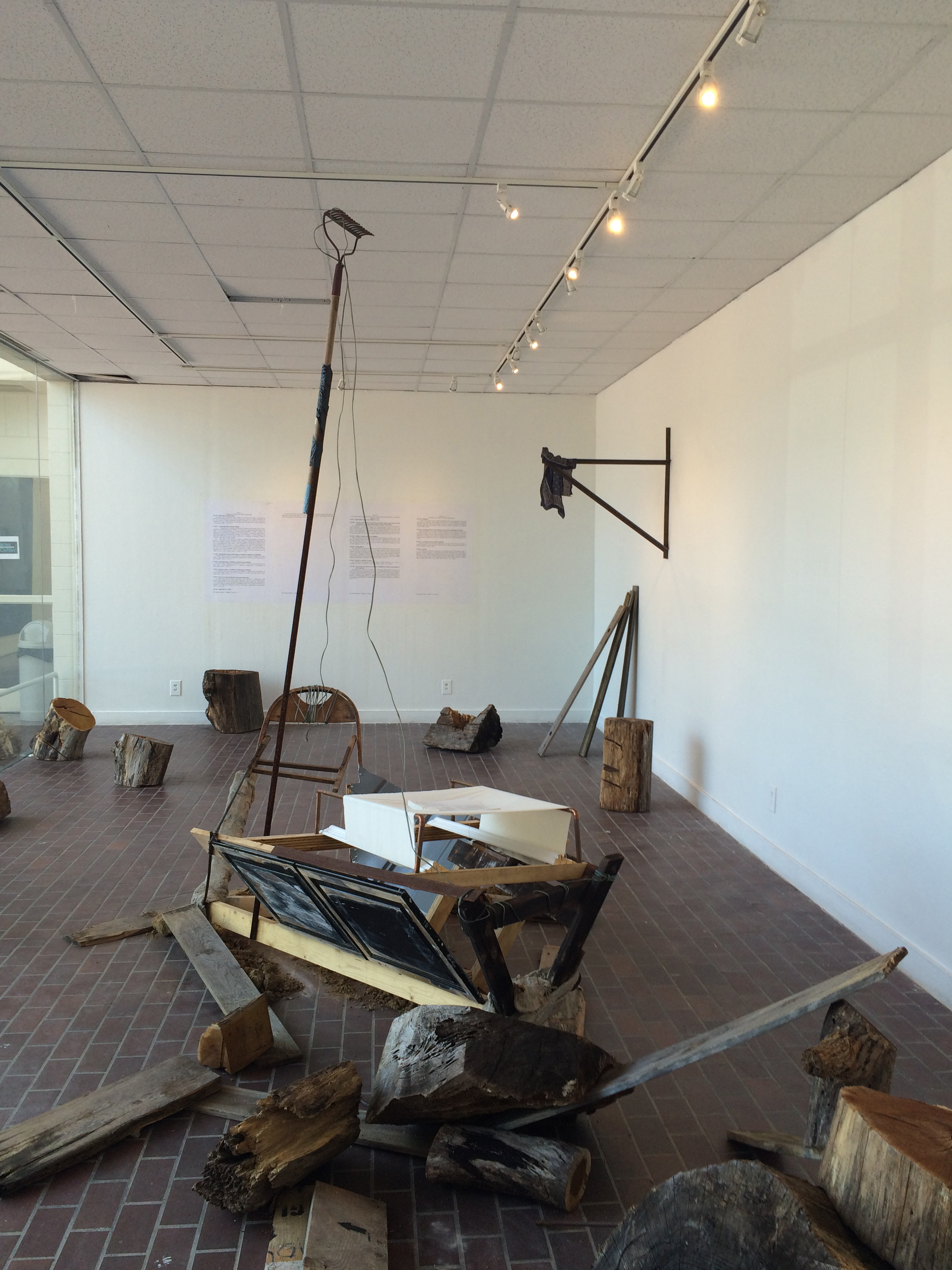 The Right to Work (installation view)  Wood, steel, NC red clay, tobacco, roofing tar,wire, textiles, and concrete  Dimensions variable, 2015