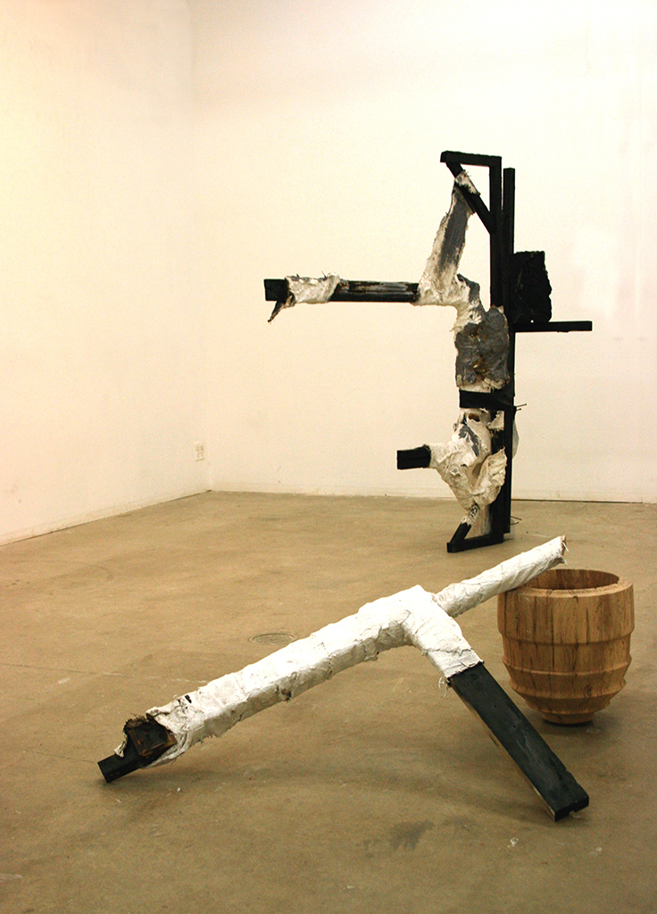 Totem for Laborers (installation view)  Charred wood, carved sculpture, burlap and plaster bandages, turned wooden vessel, roofing tar  Dimensions variable, 2015