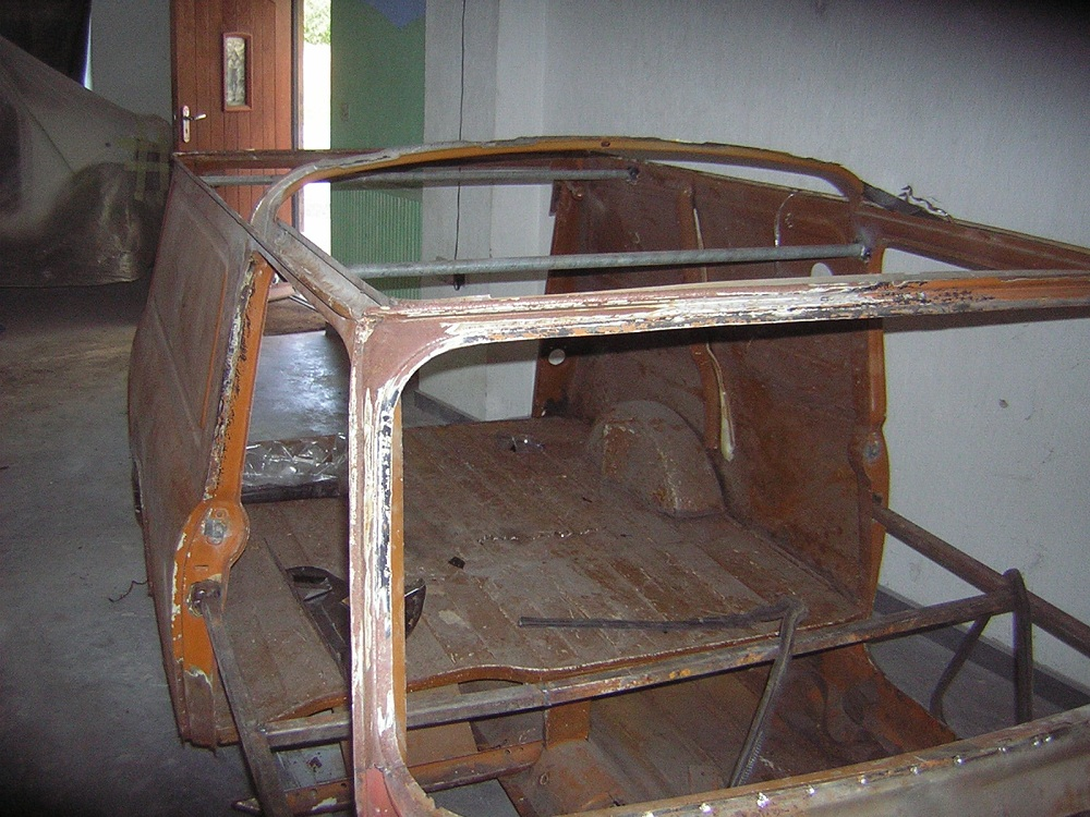 Rusted Roof of Mini Van