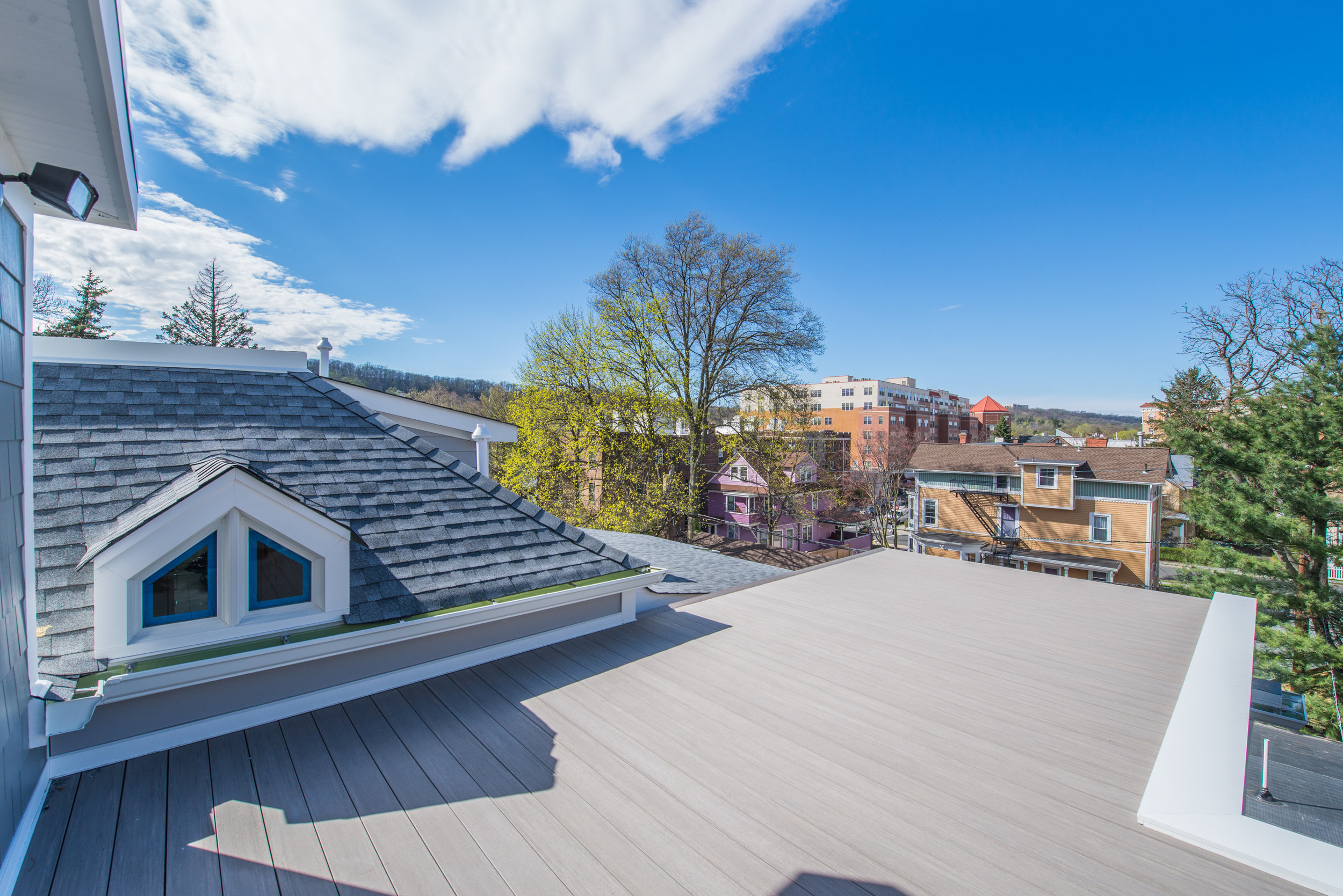 UNIT C _ Private Roof Deck View. Don't worry we have added a very nice black picket railing !