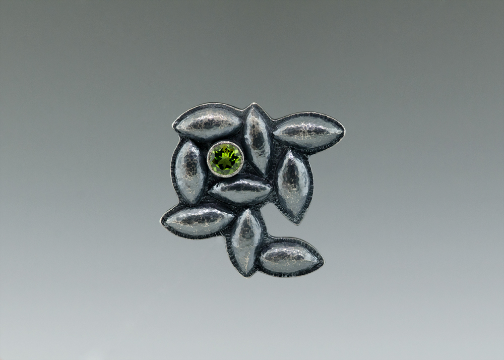 Peridot castle-quilt brooch