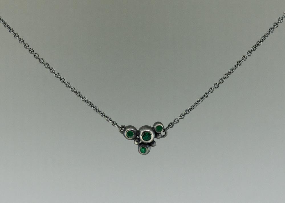 Emerald graduation necklace
