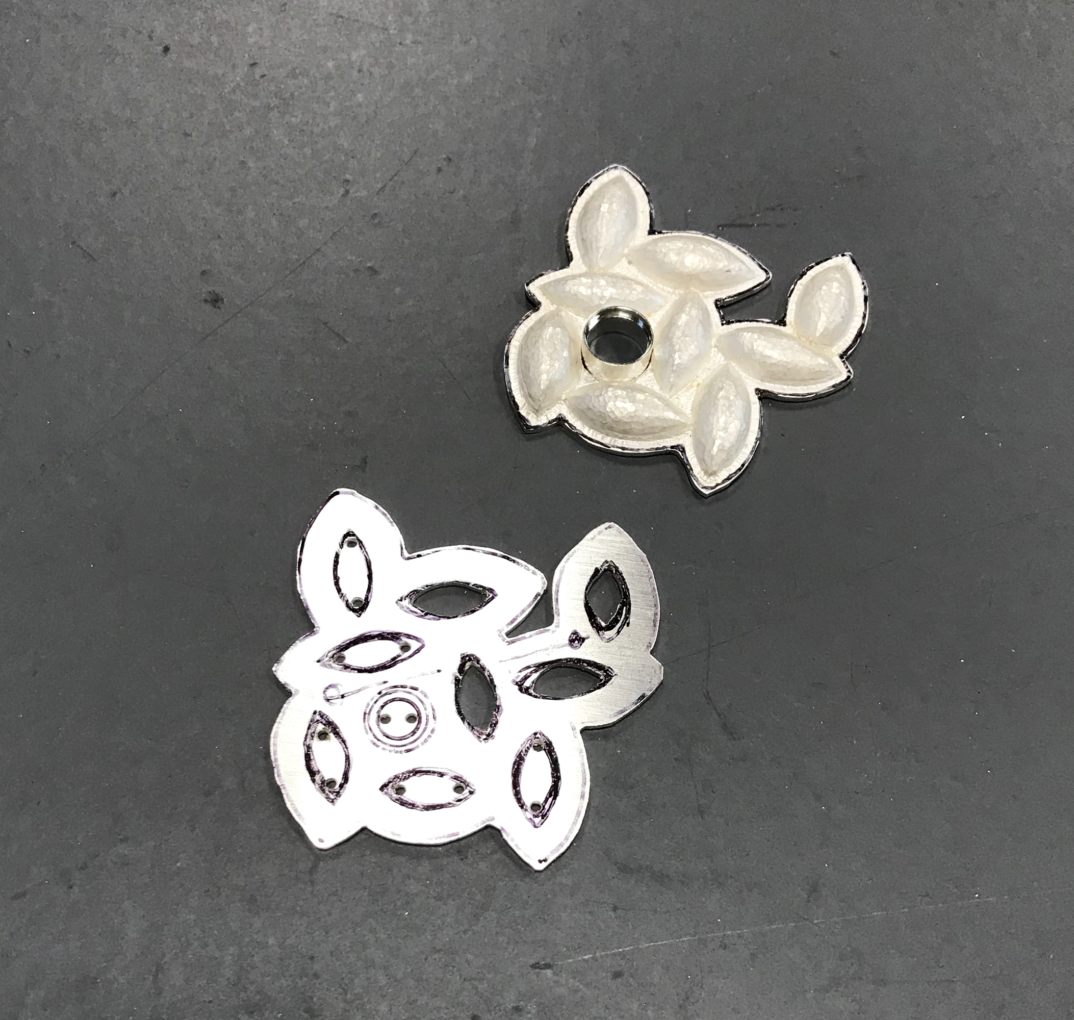 cuting parts for custom silver brooch_CG Sculpture Jewelry.jpg