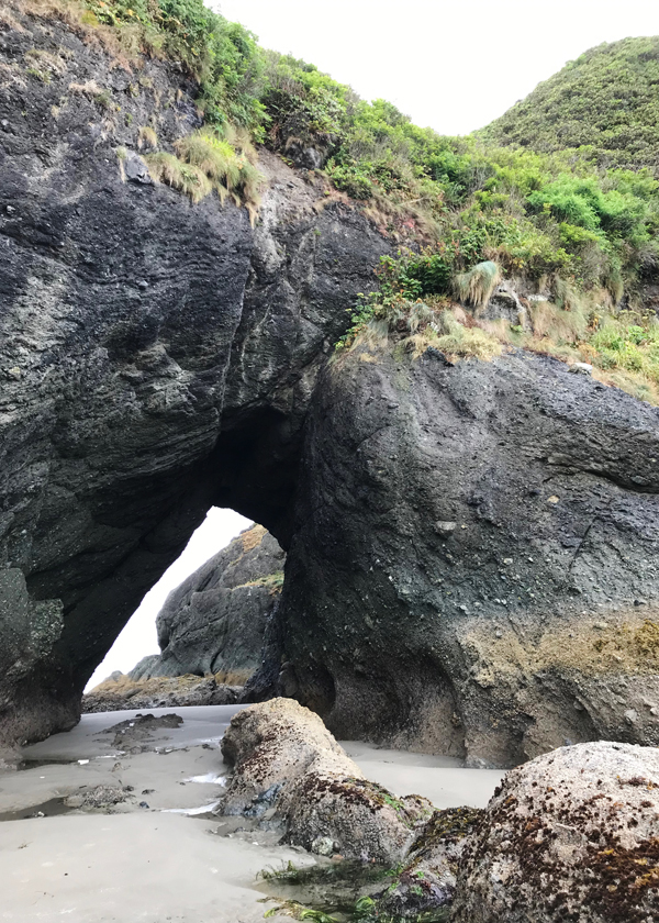 Arched rock tunnel at Point of Arches on Shi Shi Beach at Washington coast