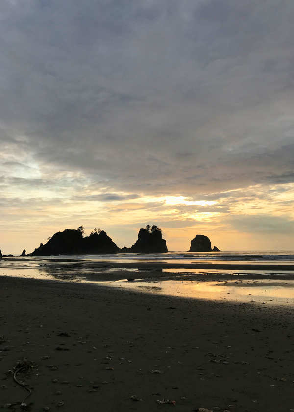 dramatic sunset behind point of arches at shi shi beach washington