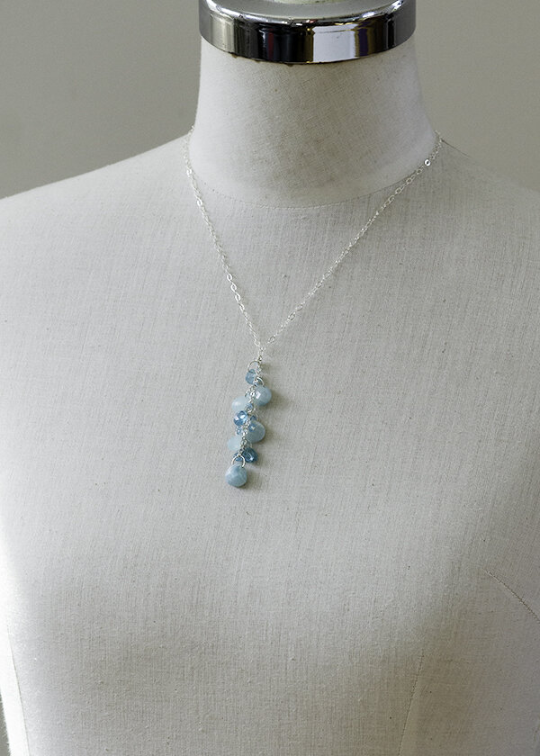 Delicate necklace with a punch. Aqua and light blue color gemstones with sterling silver cluster necklace. Adjustable necklace length. Great for everyday fashion with yoga pants and a t-shirt or pretty up a summer dress with this accessory