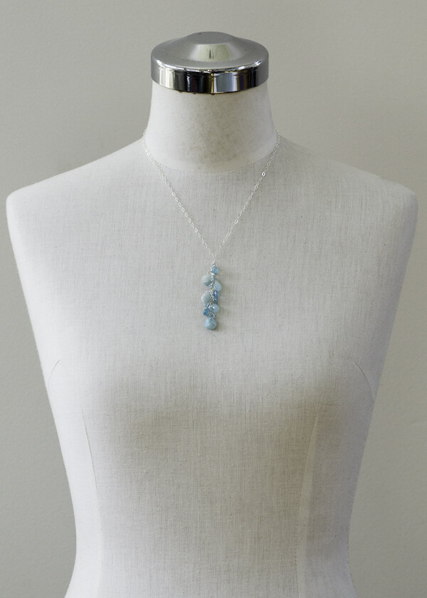 blue gemstone cluster necklace. aqua colored apatite, and light blue amazonite pair with sterling silver to make a lightweight wearable necklace perfect for summer fashion