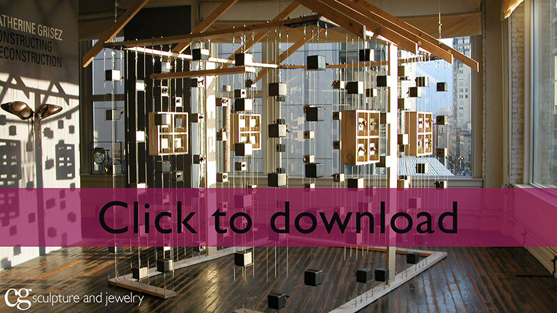 """Constructing Deconstruction - an installation of a house made of steel and bronze music box """"bricks"""" that tell the stories that make a house a home."""
