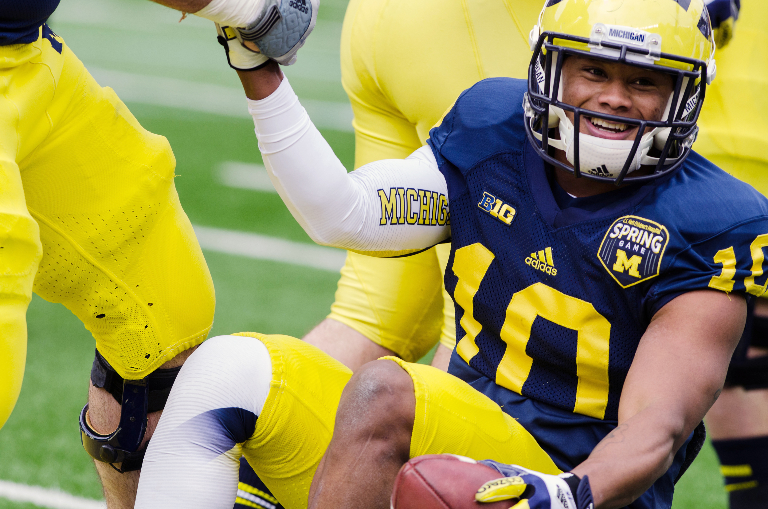 MichiganWR Jeremy Gallon receives a helping hand after running fora touchdown during the 2012 Spring Football Game.