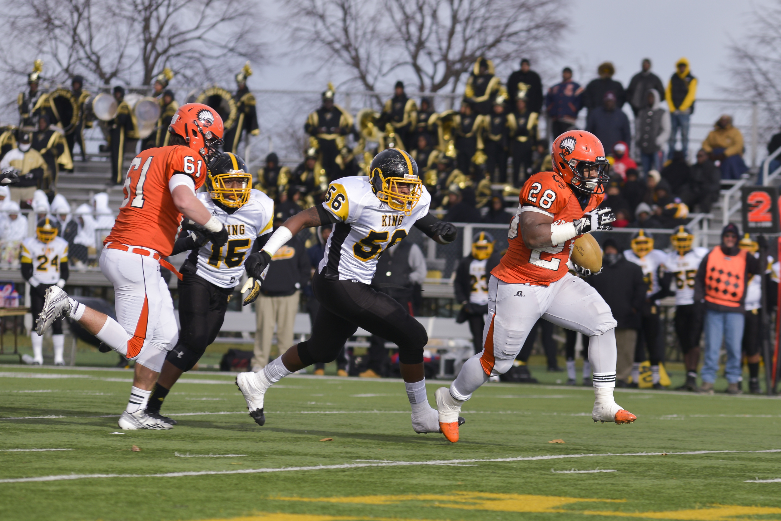 Brother Rice RB Brian Walker runs through a hole in the Detroit King's defense to score a touchdown during the MHSAA State semi-final game. In the first half alone, Walker had 10 carries for 93 yards and 4 touchdowns for Brother Rice.