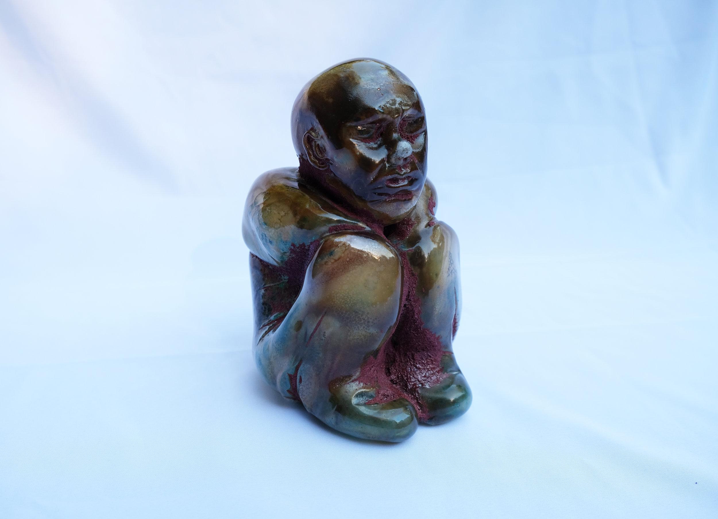 Sitting Figure.  Hot sculpting, blown glass. June 2017. 4x4.5x6.5 (h) in.