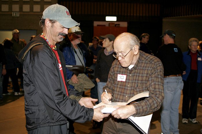 Wally Reed autographs a book at the East Auditorium Event