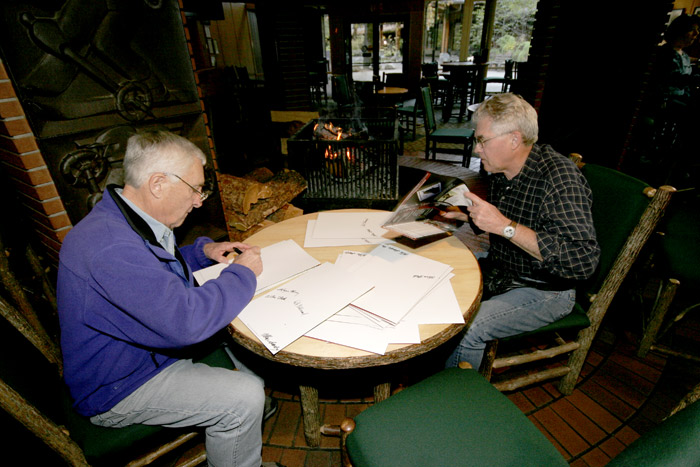 Wayne Merry and Rich Calderwood signing brochures before the Nose reunion. Chris Falkenstein photo.