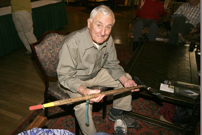 Wayne Merry in the Ahwahnee Hotel looking at a well autographed ice axe.
