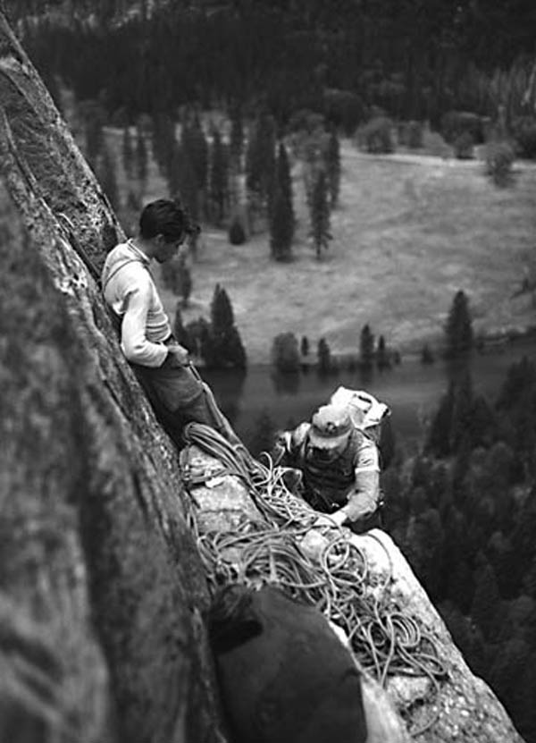 Warren Harding belaying Jack Davis during the first ascent in 1955.