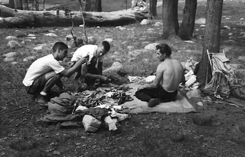 Warren racking up in El Cap Meadow probably for the Leaning Tower. I need help identifying the other two men.That is Al MacDonald on the left and a young Glen Denny  with Harding so it must be racking for the Leaning Tower..jpg