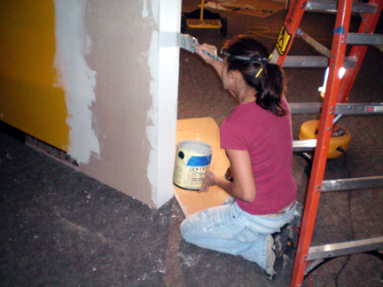 Katherine is painting the newly installed walls