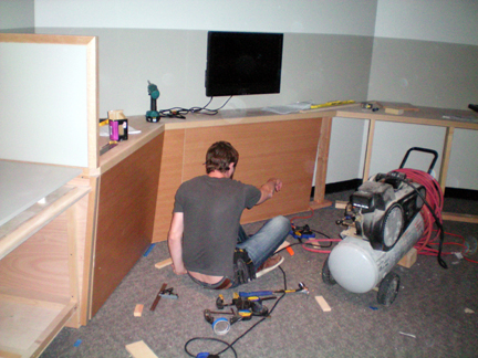 Some of the cabinets are being built in place. All the cabinets have no hardware showing.
