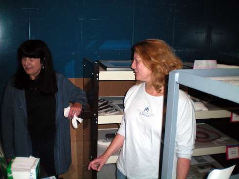 Andi and Anne are overseeing installation of the artifacts.