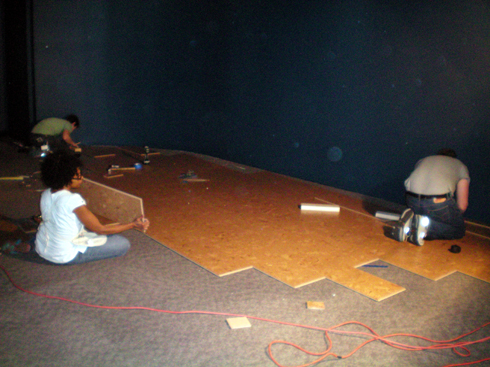 Installing the dirt and pine needle colored flooring in the Camp 4 section.