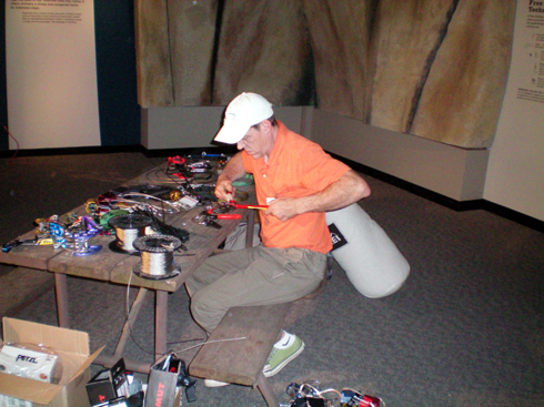 Steve Grossman swaging the shiny gear to the authentic redwood table in the Camp 4 section.