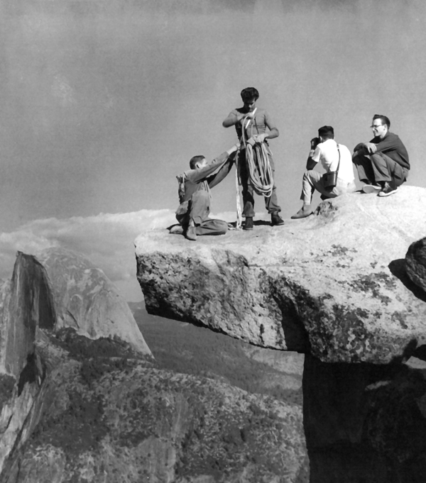 Don Wilson, Warren Harding, Jerry Gallwas and Royal Robbins on top of Glacier Point. They are posing for a San Francisco Chronicle article in 1955. Photo Jerry Gallwas collection. Fall 55