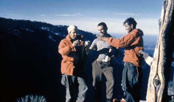 George Whitmore, Wayne Merry and Warren Harding toast each other on the summit of the Nose November 12, 1958. Photo taken by Ellen Searby with Wayne Merry's camera.