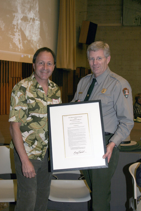 Superintendant Mike Tollefson presenting Ken Yager a framed copy of the Congress Resolution commemorating the 50th anniversary of the first ascent of the Nose, El Capitan.