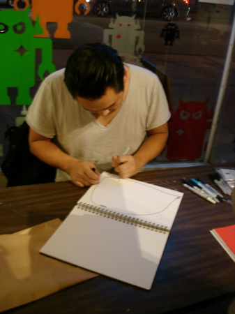David-Choe-Signing-Giant-Robot-05