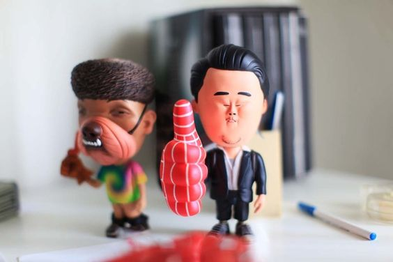 David Choe and Harry Kim Thumbs Up figures created by sculptor  Wilfrid Wood