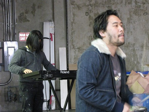 James Jean and David Choe on the keyboards and drums at David Choe's warehouse in Los Angeles, California.