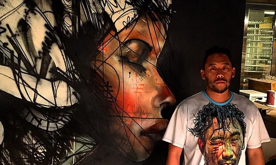 David Choe by his mural at Momfuku Ko, New York