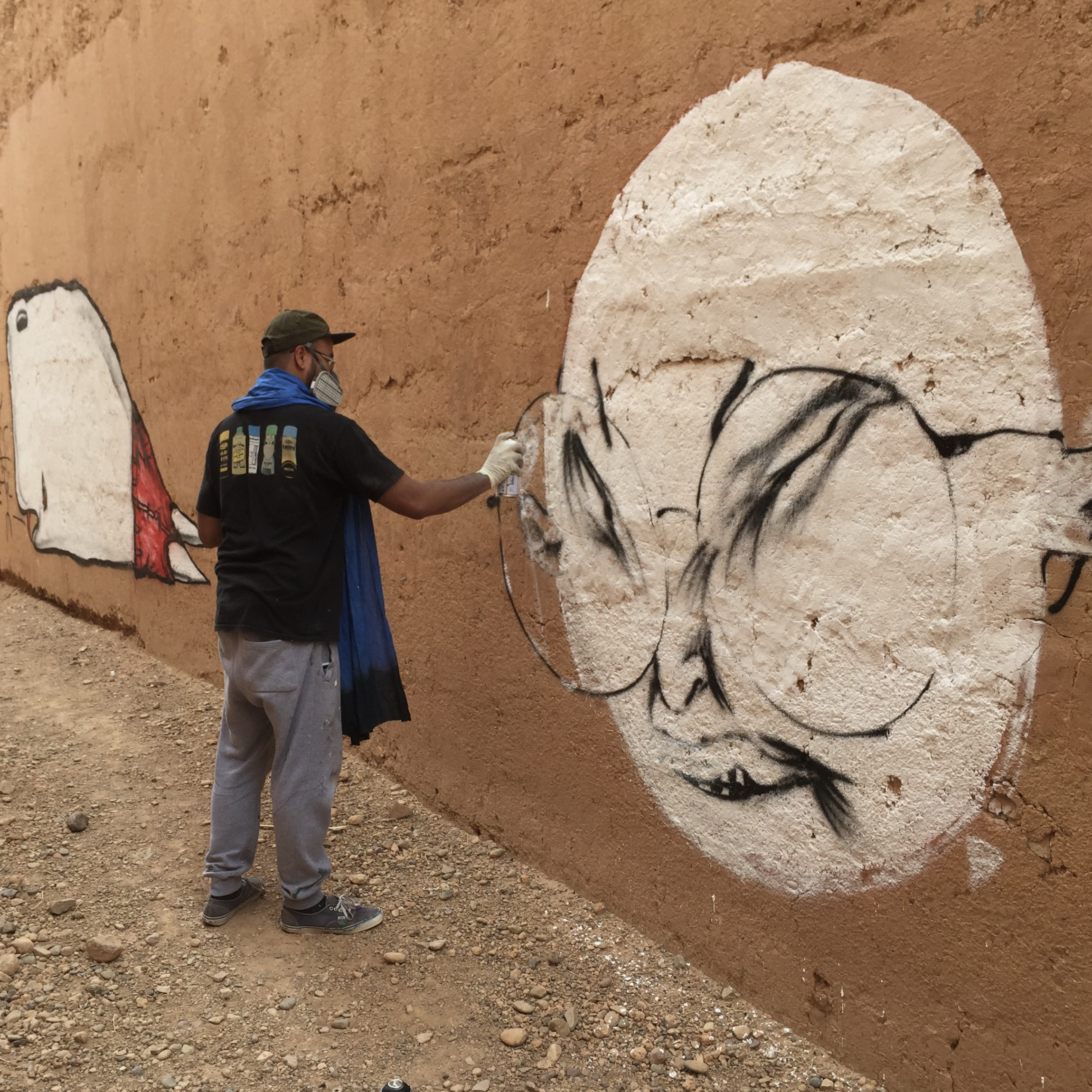 Artist Andrew Hem painting a mural for the Igloo Hong art project in Morocco 2016