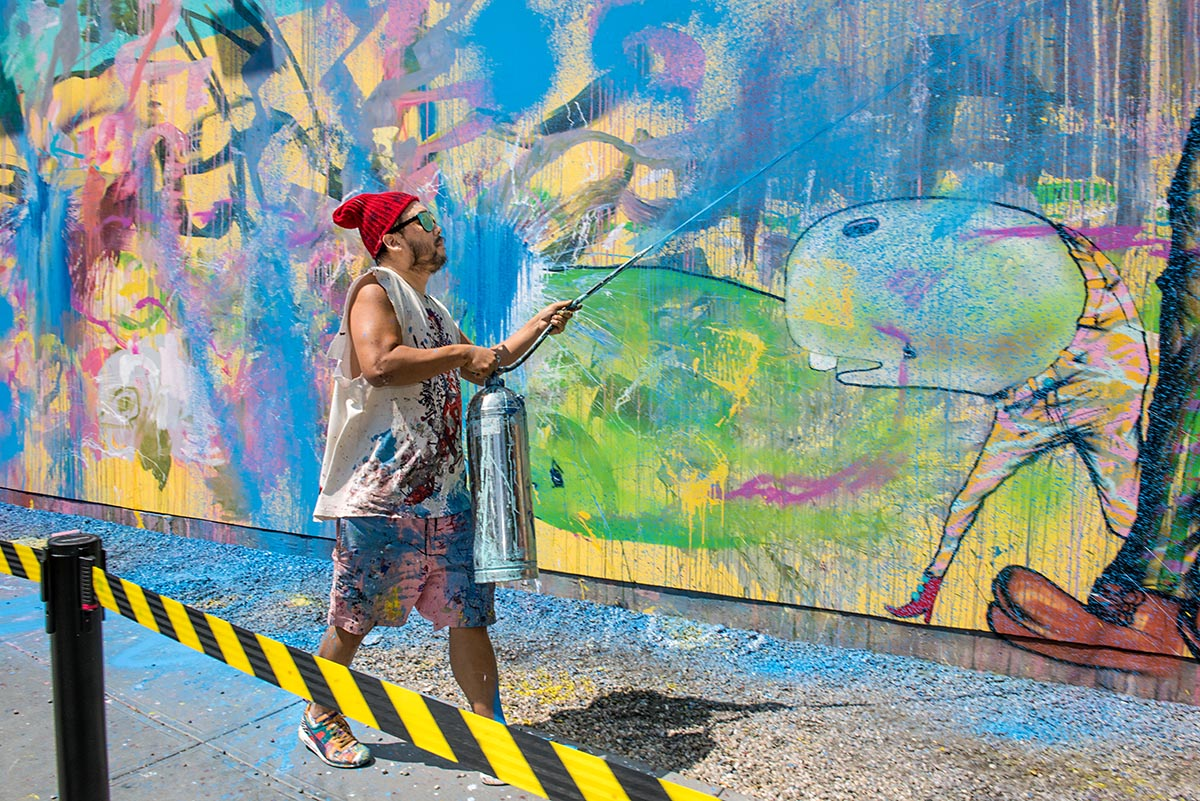 David Choe paints with a fire extinguisher for a new mural at the Bowery in New York