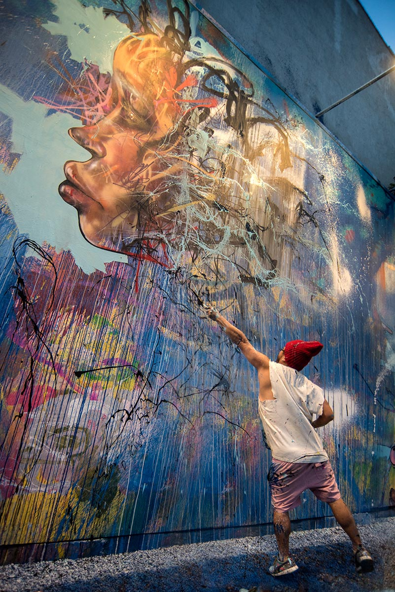 David Choe painting a mural at the Bowery Wall New York. Photo by Martha Cooper.