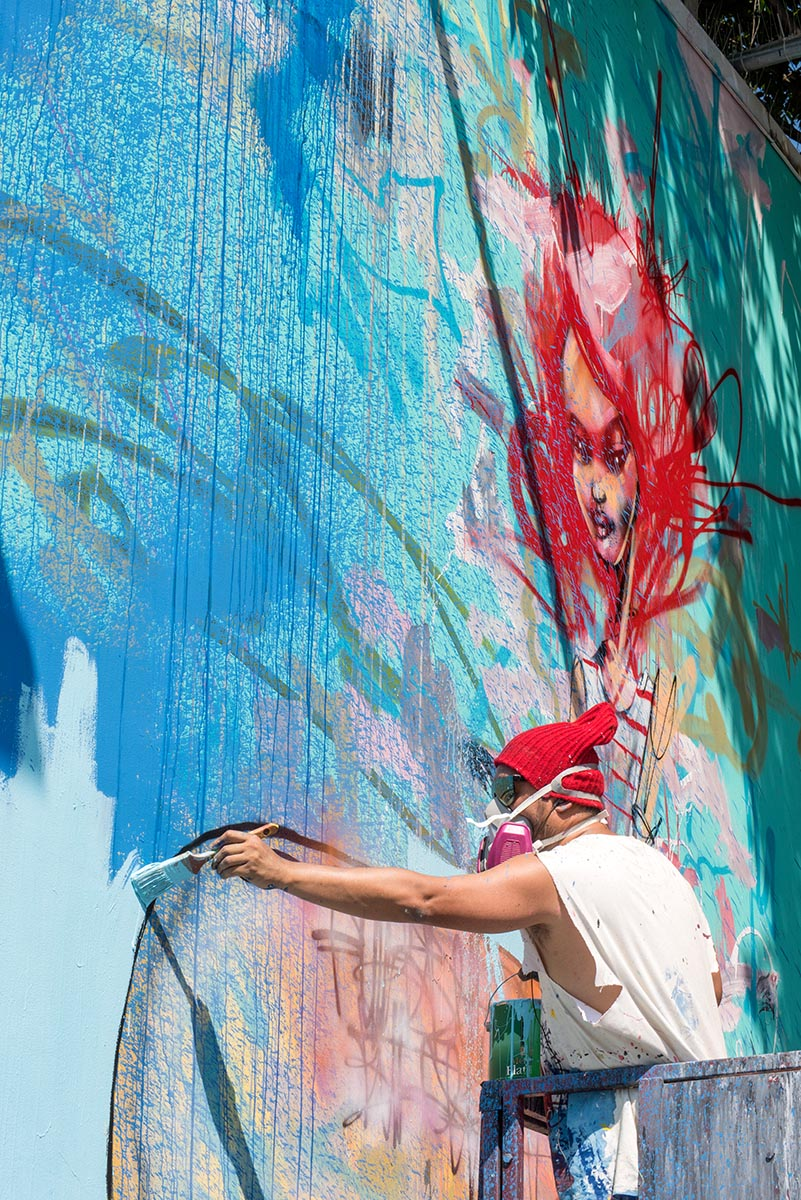 David Choe painting a mural at the Bowery, New York. Photo by Martha Cooper.