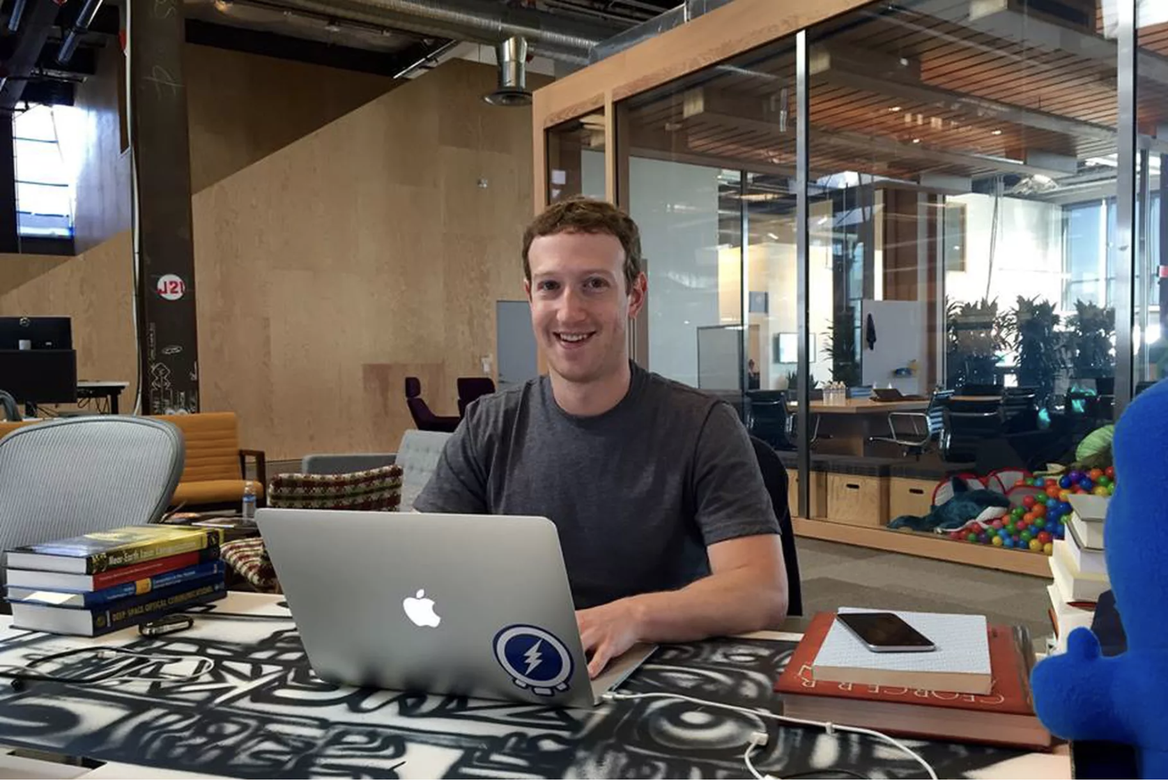 Mark Zuckerberg sitting at his desk painted by artist David Choe at Facebook HQ