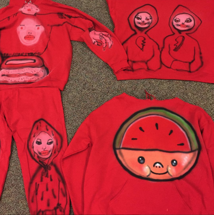 David Choe spray painted red sweat suits for the Choe Show Los Angeles