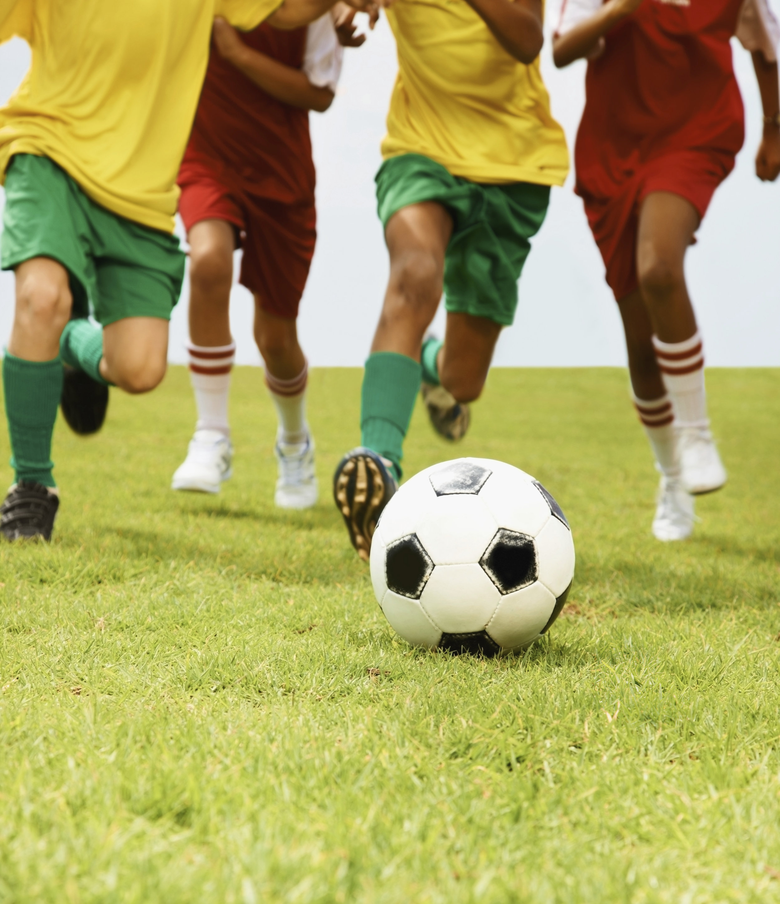Group-of-children-playing-football-in-a-stadium-000011846561_Double.jpg