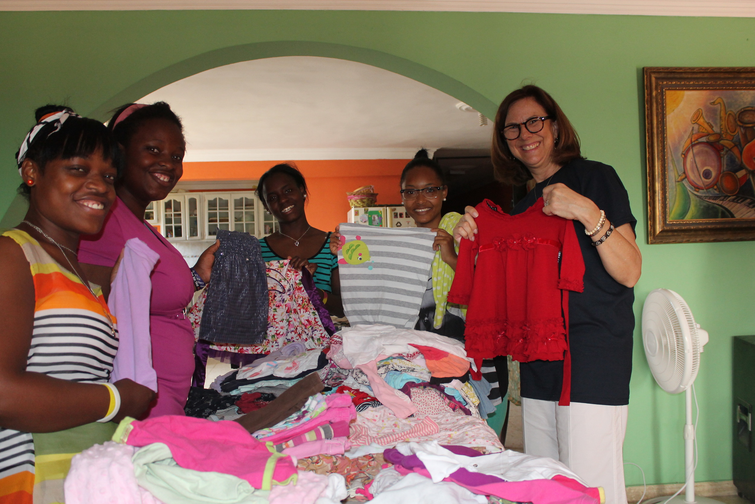 Sorting the beautiful baby clothes