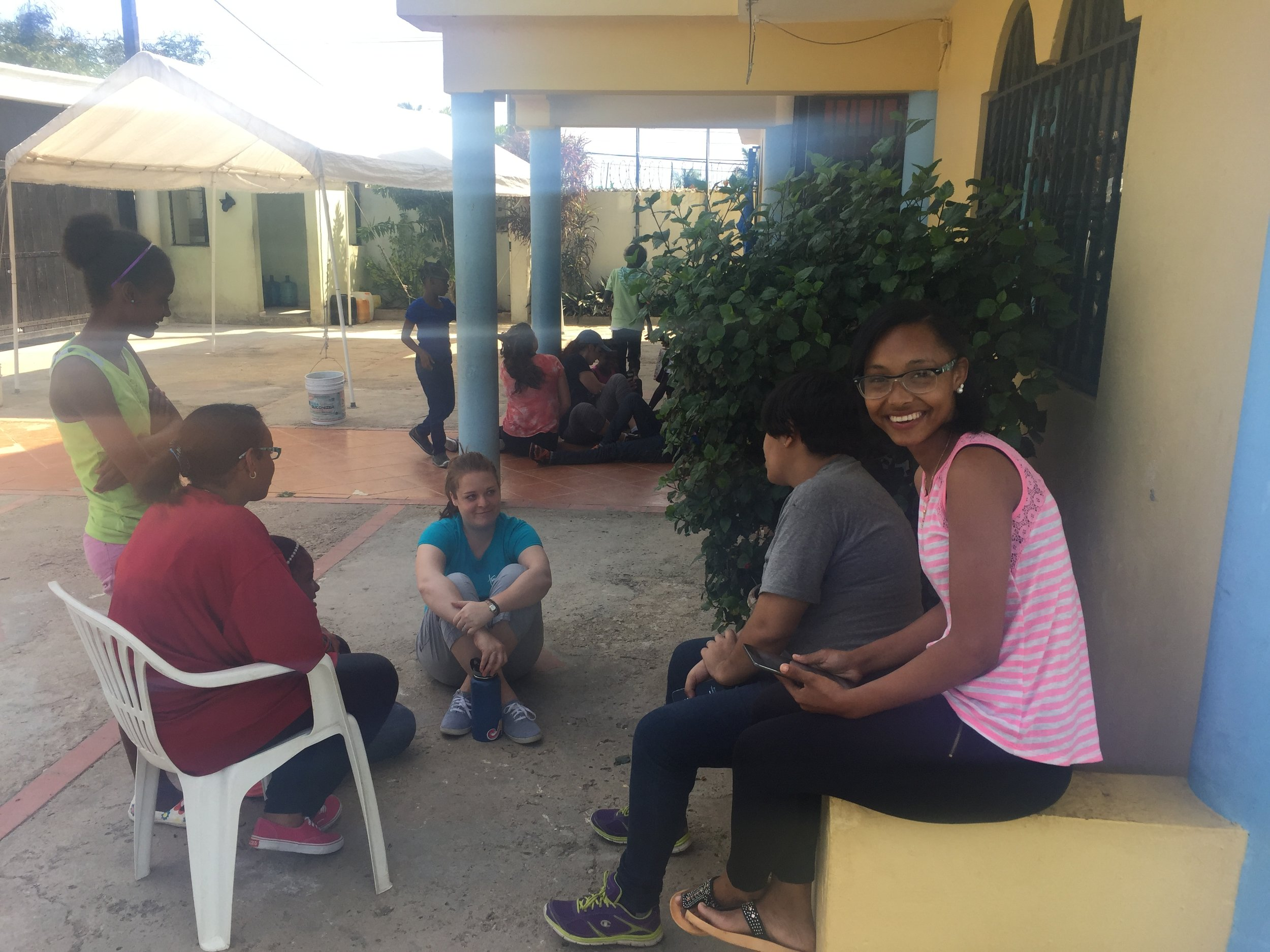 Jessica, our Vision Trust team leader (sitting on ground) chats with the Remar young women who have grown up at the orphanage.  Maricela (looking at camera) is a special friend.