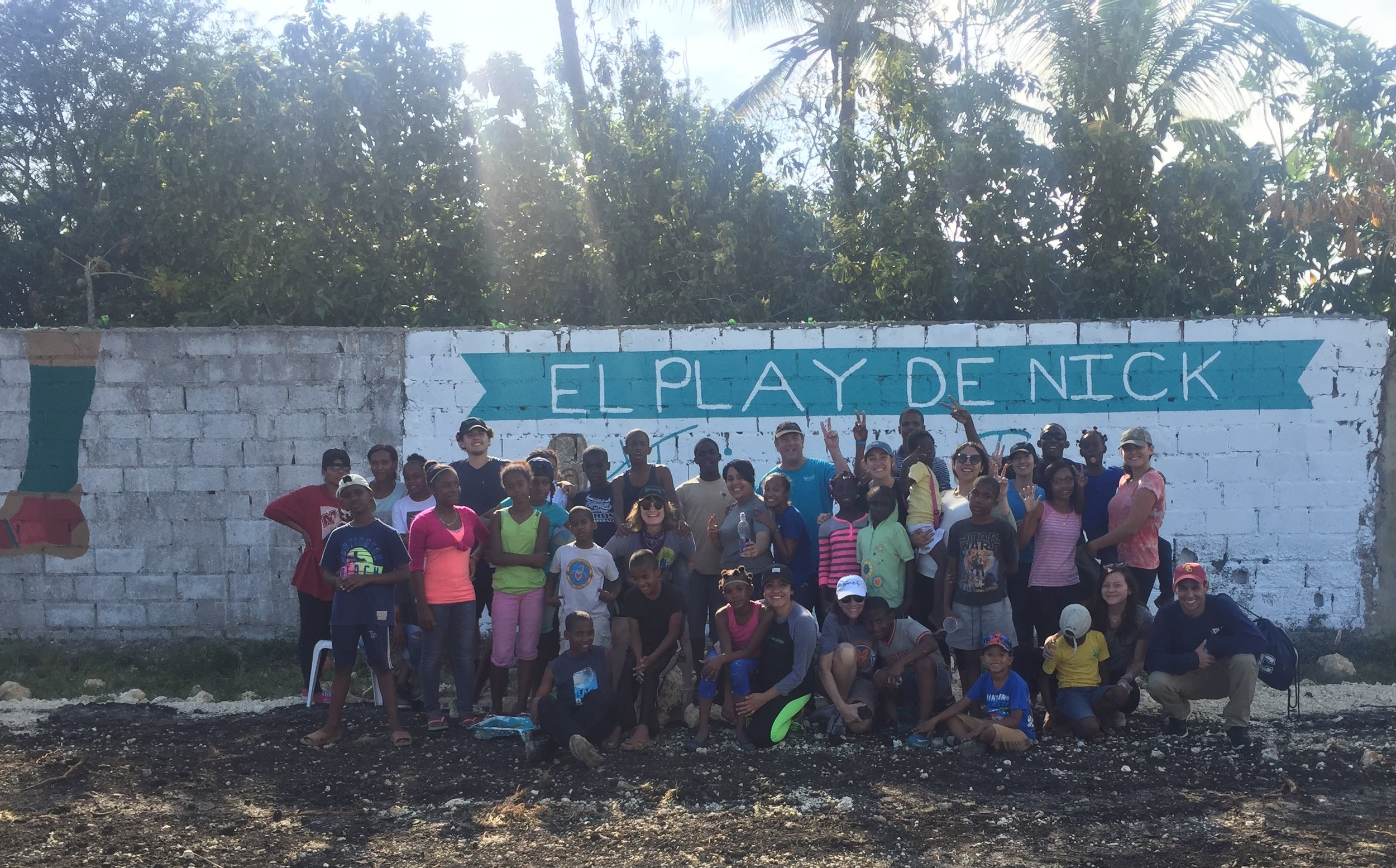 The Remar Orphanage Family Celebrates the finished murals with the Caruso Catholic Center Team