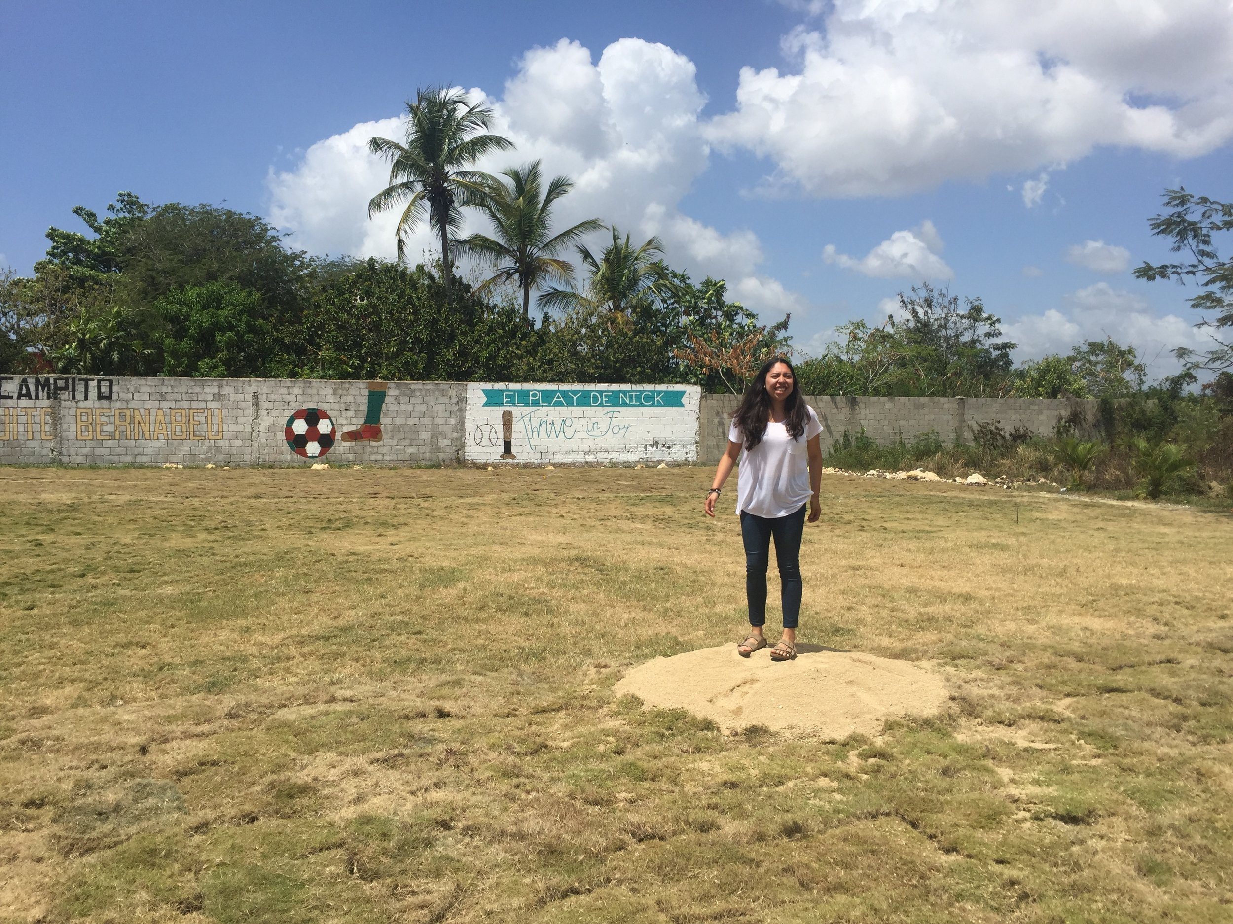 Elizabeth tests out the Pitcher's Mound